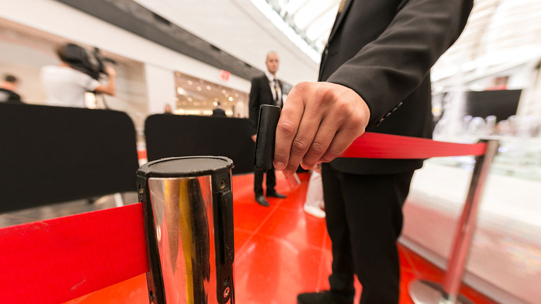 Close up of a hand opening a vip barrier rail - event security - close protection